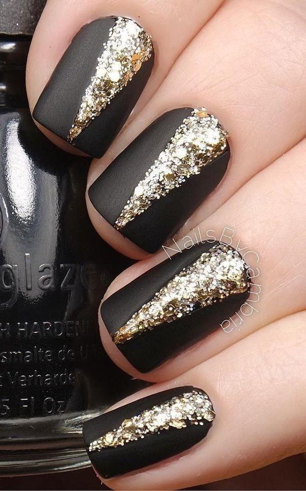Elegant-Black-Matte-Nails-With-V-Shaped-Gold-Embellishments-On-Top Elegant Black Nail Art Designs