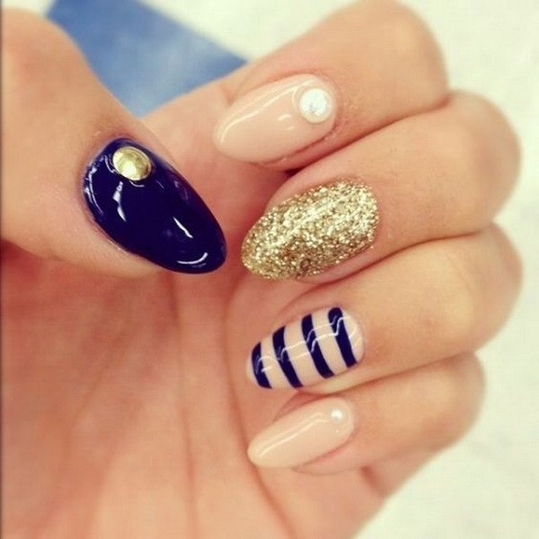 Alysa Queen Navy-And-Nude-Almond-Nail-Design-With-Glitter-And-Strips-Details