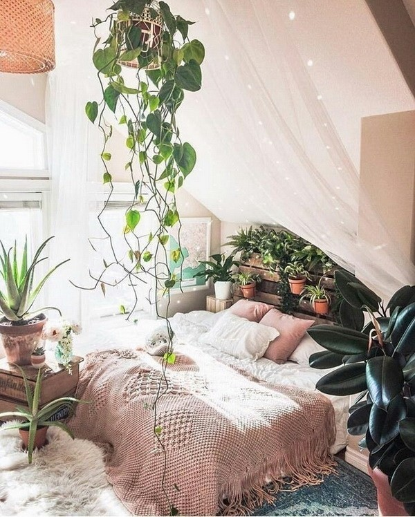 Romantic-bohemian-bedroom-with-canopy-and-lots-of-plants-inside Chic Bohemian Interior Design Ideas