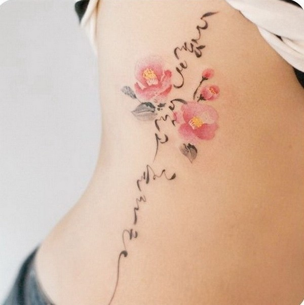 Camellia-And-Korean-Calligraphy-Tattoo-On-Side Pretty Flower Tattoo Ideas