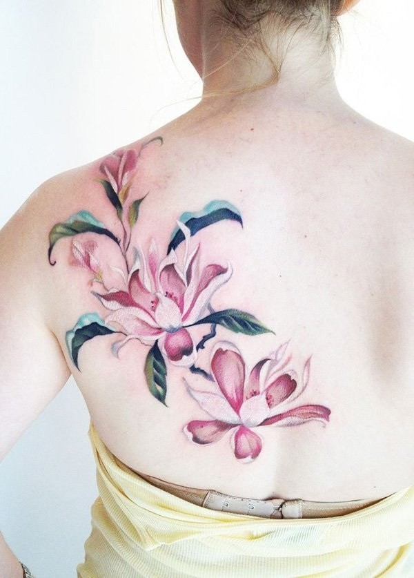 Pink-Magnolia-Flower-Tattoo-On-The-Back Pretty Flower Tattoo Ideas